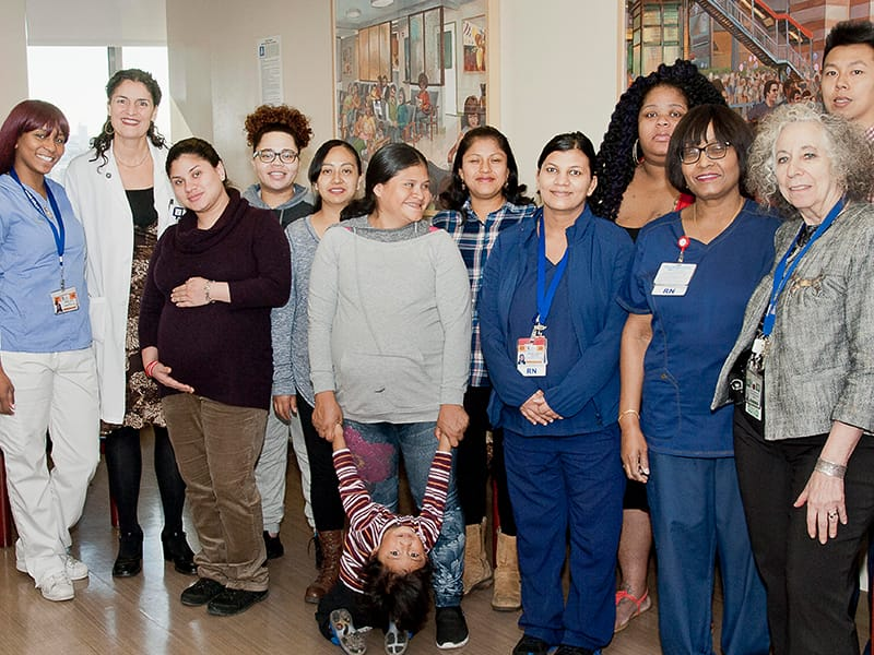 Jessica Lynn with patients and colleagues