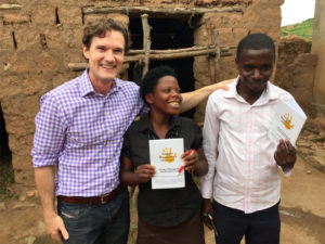 Jason Baker with patients in Uganda