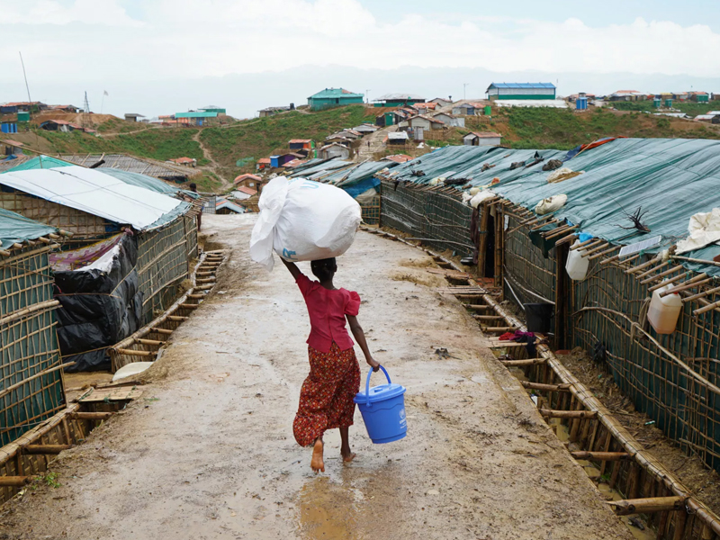 Young Rohigya girl walking in refugee camp