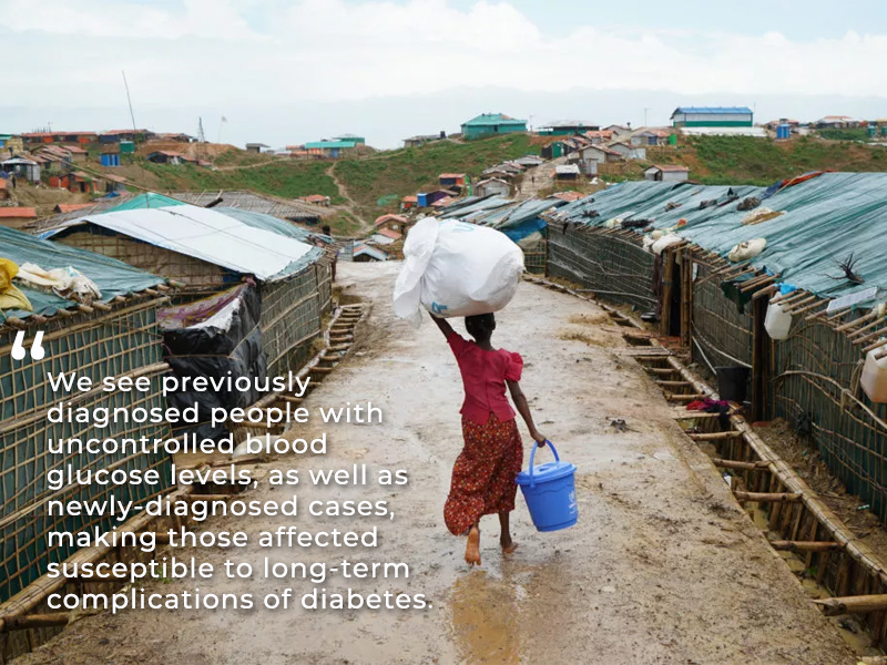 Rohingya girl walking with bucket