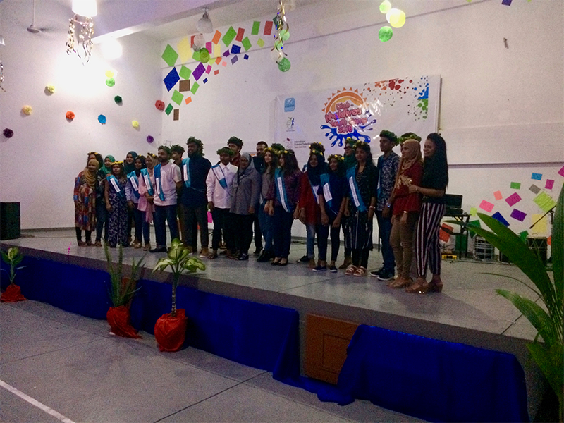 Maldives camp group picture on stage