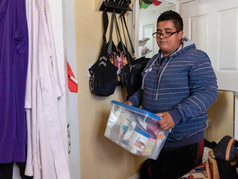"Jesse Guerrero helps take care of his mom, who has diabetes. ""I want her to get better so we can finally go places,"" he says.(HEIDI DE MARCO/KHN)"