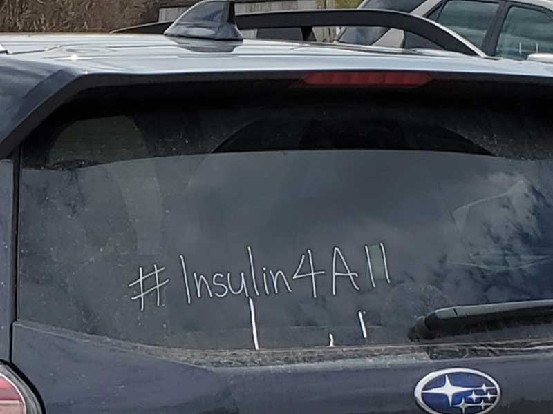Car with the campaign hashtag #insulin4all
