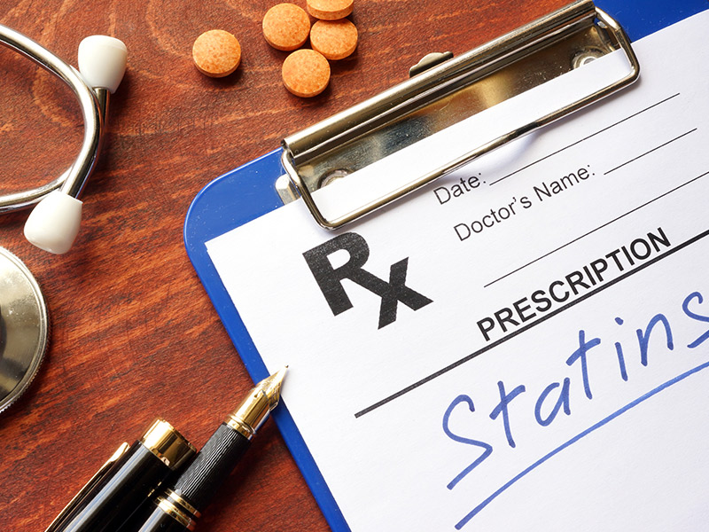 Clipboard with written prescription statins and stethoscope