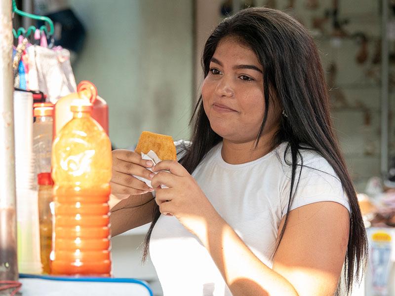 Girl having a snack outside