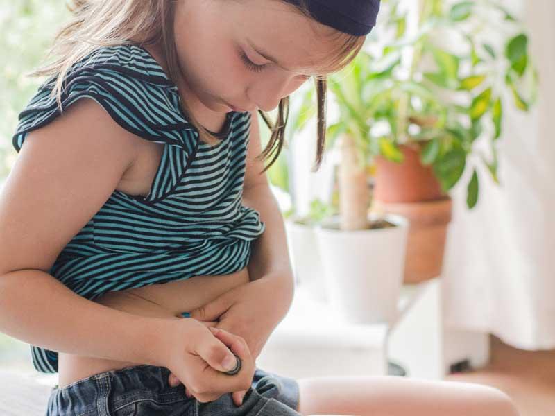 Girl injecting insulin